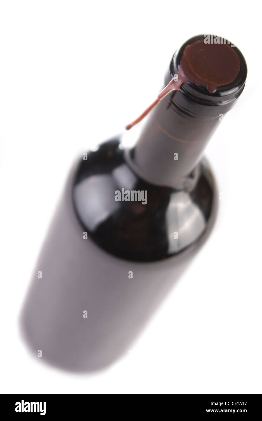 Unopened bottled of red wine isolated on white. Selective focus. - Stock Image