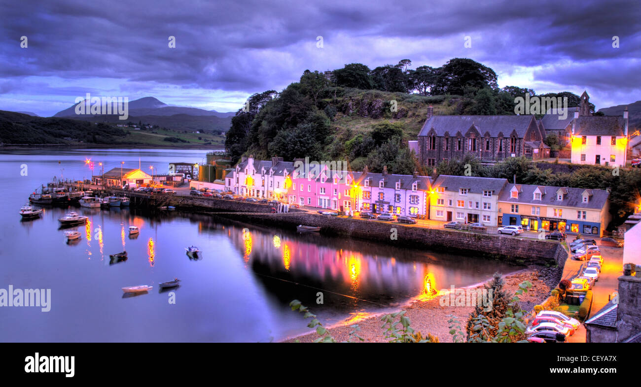 Portree Harbour, Isle Of Skye at dusk. Night lights of the boats and houses reflected in the beautiful fishing boat Stock Photo