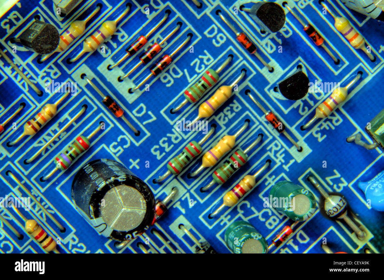 Blue Printed Circuit Board with resistors, capacitor and transistors, from Bosch Worcester central heating boiler - Stock Image