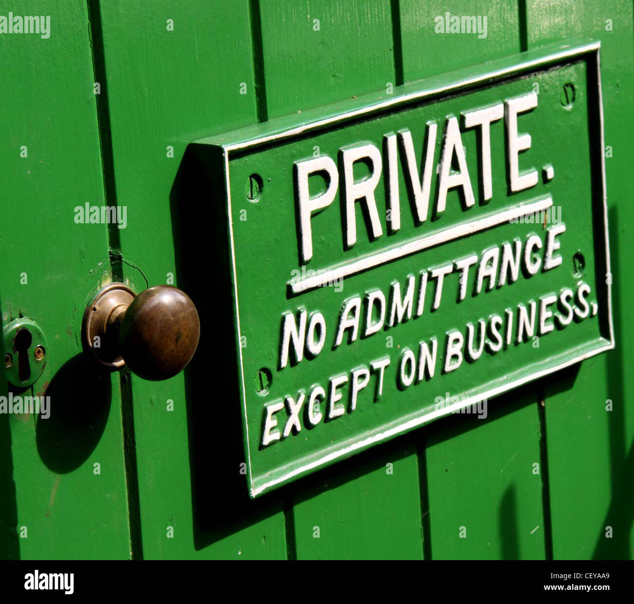 Private No Admittance Except On Business GWR Great Western Railway sign on a green door. Woody Bay, North Devon, - Stock Image
