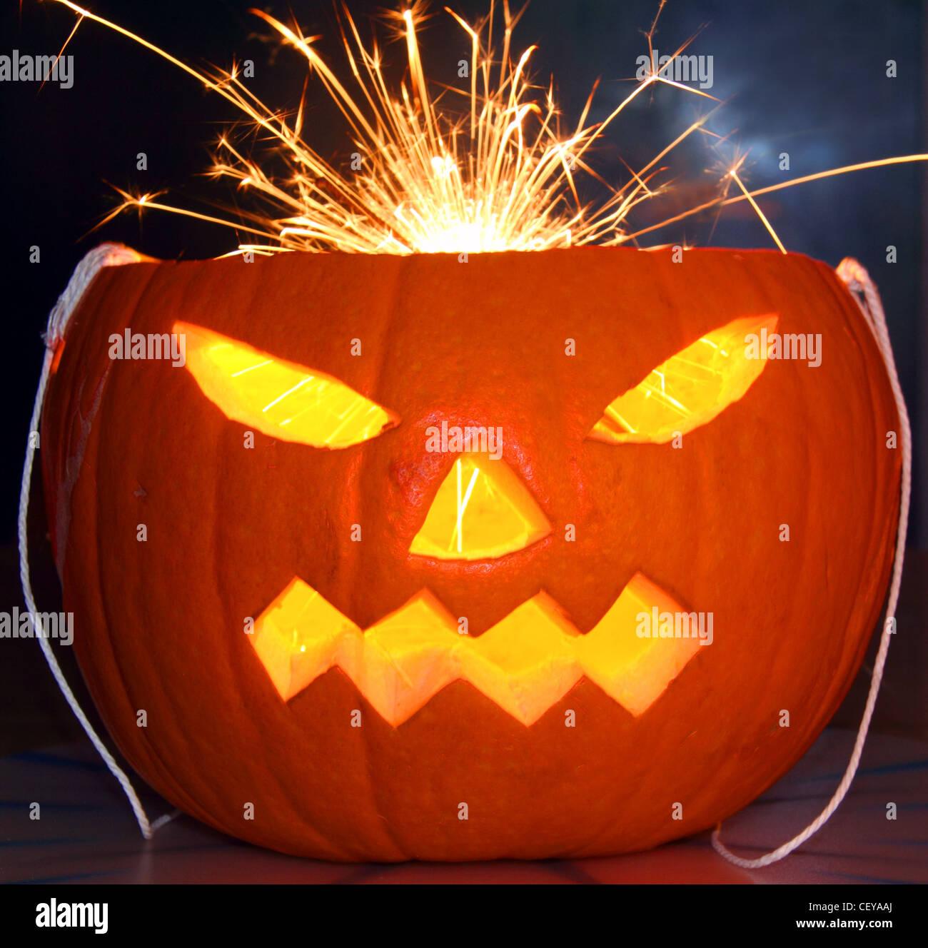 Orange Halloween Pumpkin with a sparkler for hair - Stock Image