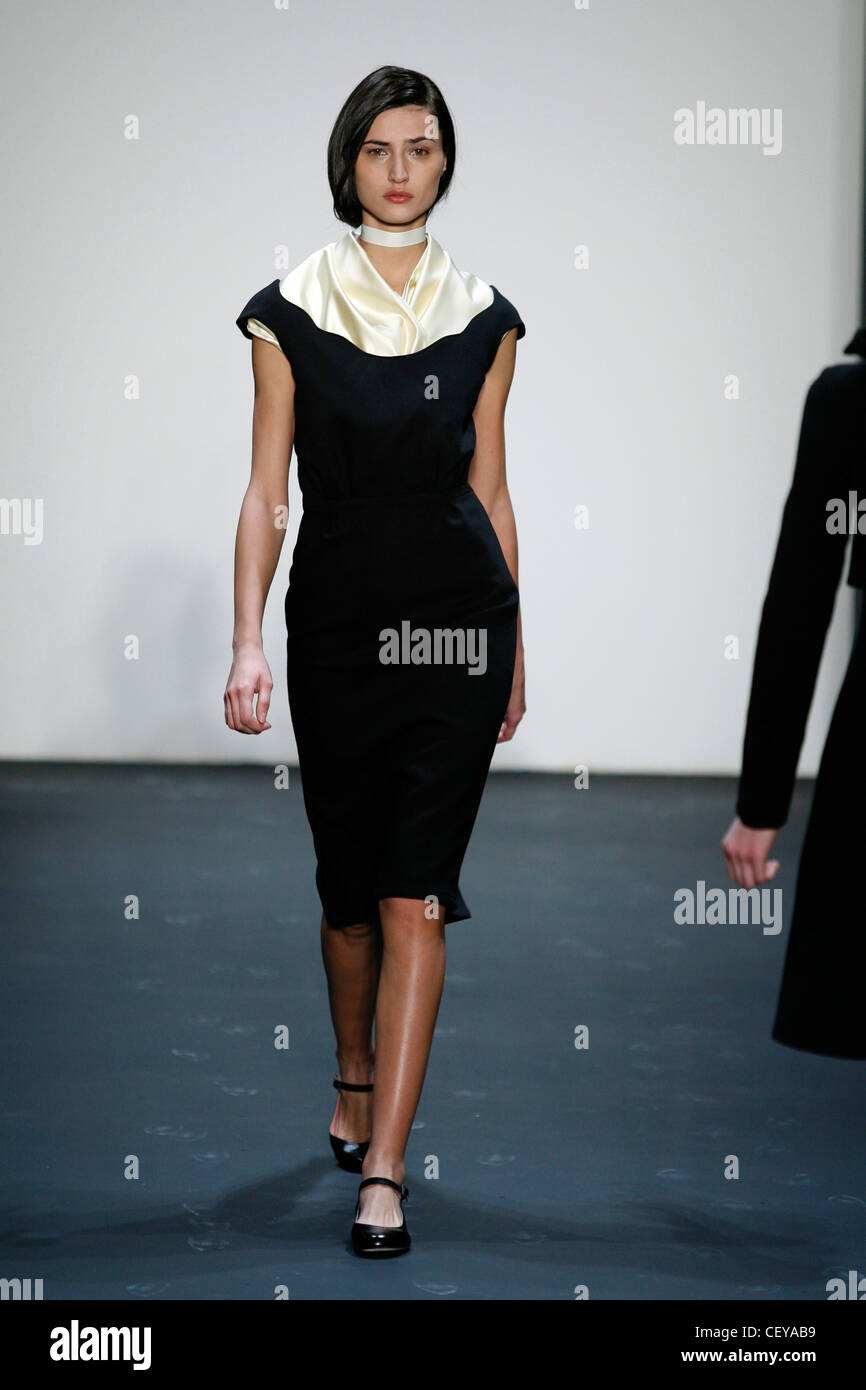 9968e9f24917 Dragana Ognjenovic New York Ready to Wear Autumn Winter Brunette female wearing  black knee length pinadress