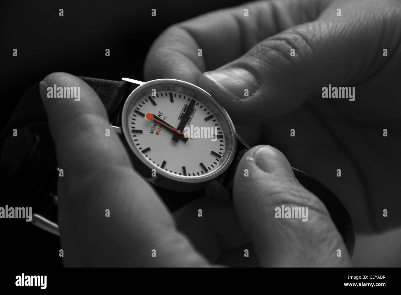 Resetting a watch for daylight saving time or British Summer Time BST by one hour in March and October. - Stock Image