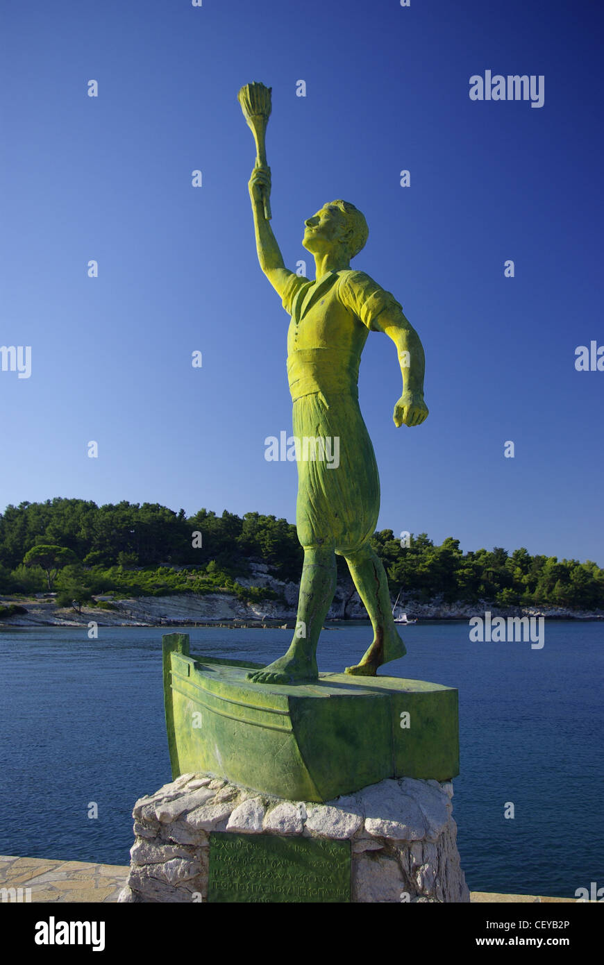 The statue of  Georgios Anemogiannis at the entrance of Gaios harbour, on the island of Paxos, Greece - Stock Image