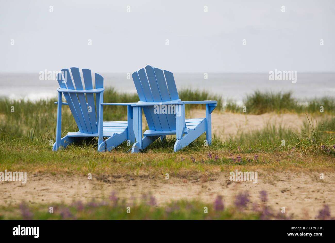 Two Blue Adirondack Chairs On A Grassy Beach Oregon United
