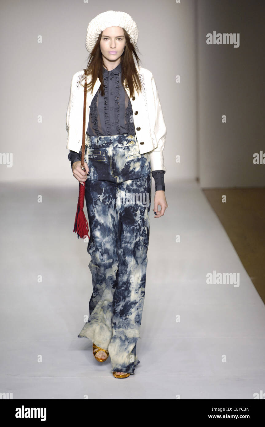 5be34423 Karen Walker New York Ready to Wear Autumn Winter Ruffled shirt, blue tie  dye trousers, white jacket and a white knitted hat