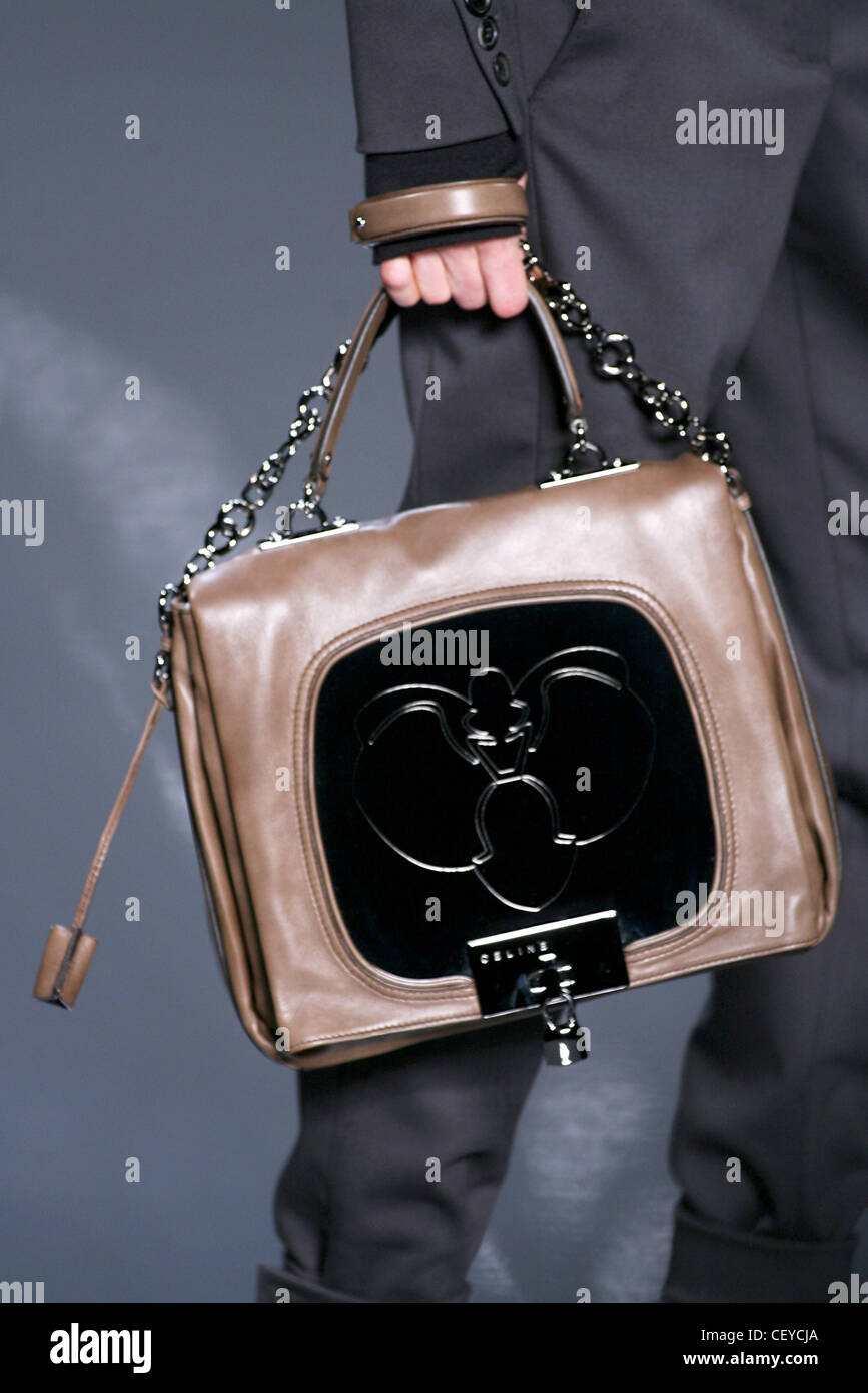 Celine Paris Ready to Wear Autumn Winter Model carrying brown leather  handbag black panel and bug design ee0b95f6663fd