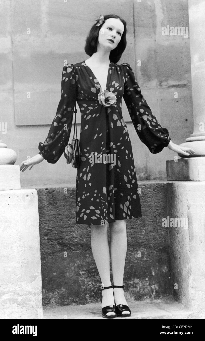 3b323eabef1 Yves Saint Laurent Rive Gauche Spring Model wearing a nostalgia dress in  silk crepe printed hearts and lips bloused sleeves and