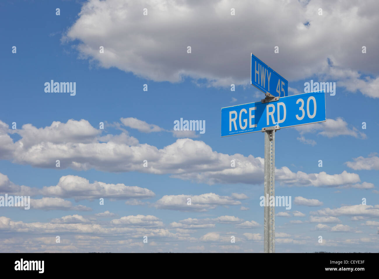 signs of two intersecting roads; alberta canada - Stock Image