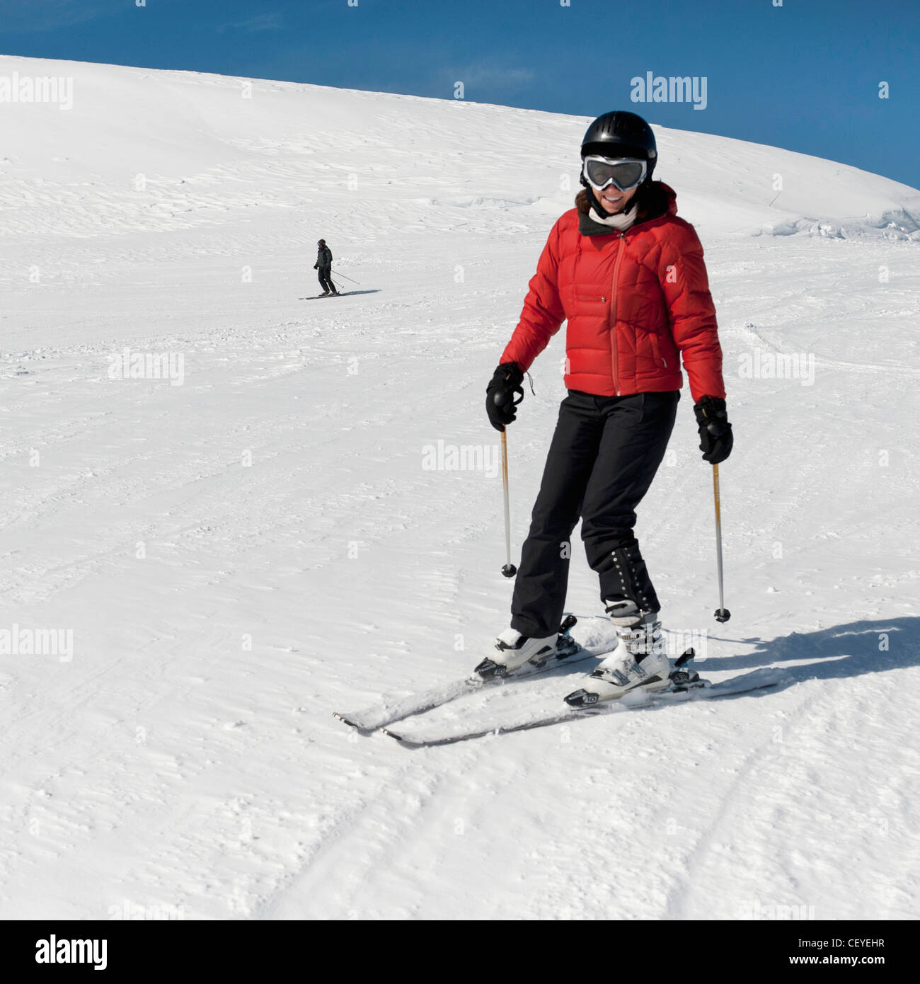 a skier making their way down a hill; whistler british columbia canada - Stock Image
