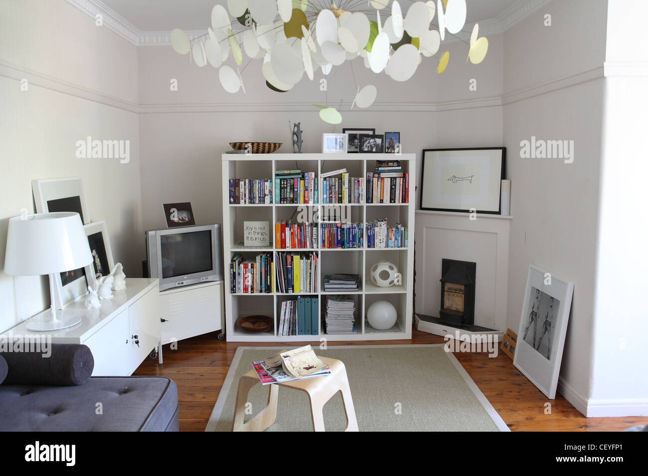 Apartment in Sydney Living room interiwith corner sofa from Habitat, white metallic low cabinet from Ikea, Butterfly Stock Photo