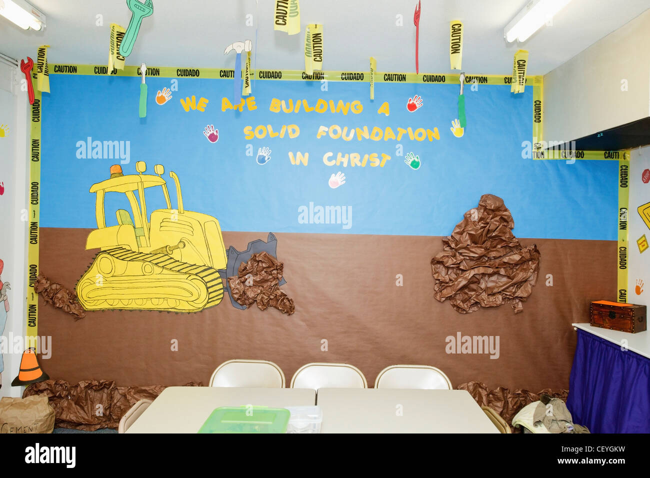 a construction illustration on a sunday school classroom wall; portland oregon united states of america - Stock Image