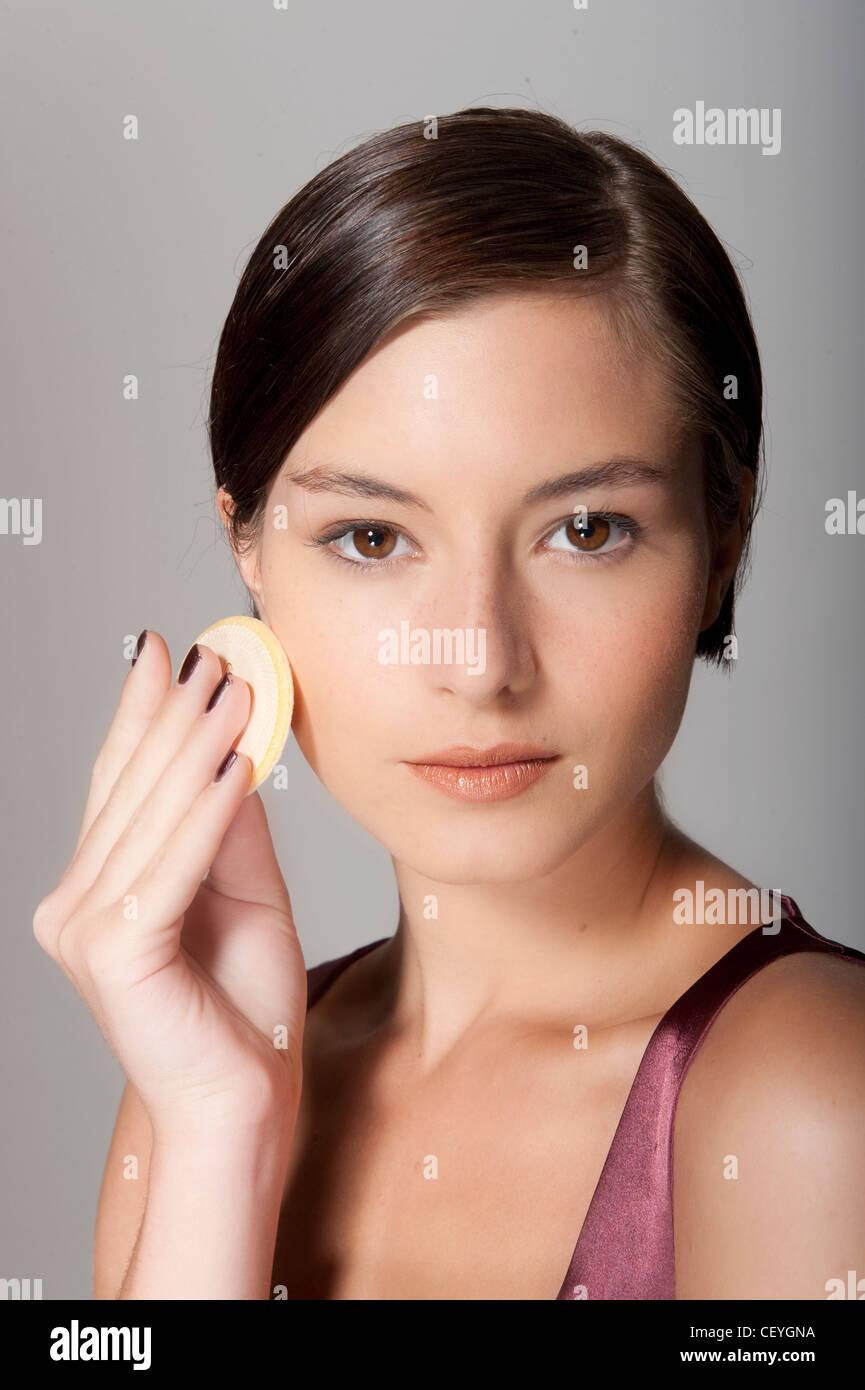 Step By Step Make Up Female Short Brunette Hair Applying Foundation Stock Photo Alamy