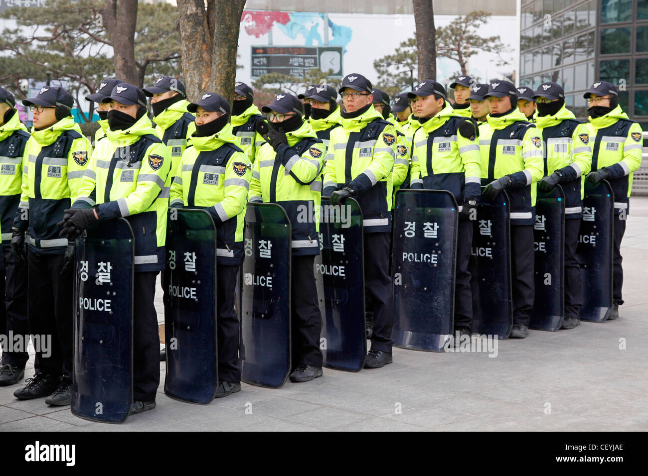 Korean riot police with riot equipment and shields in Seoul, South Korea - Stock Image