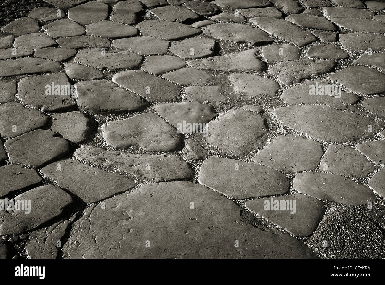 ancient flagstones fit together like a jigsaw puzzle in the roman forum rome italy Stock Photo