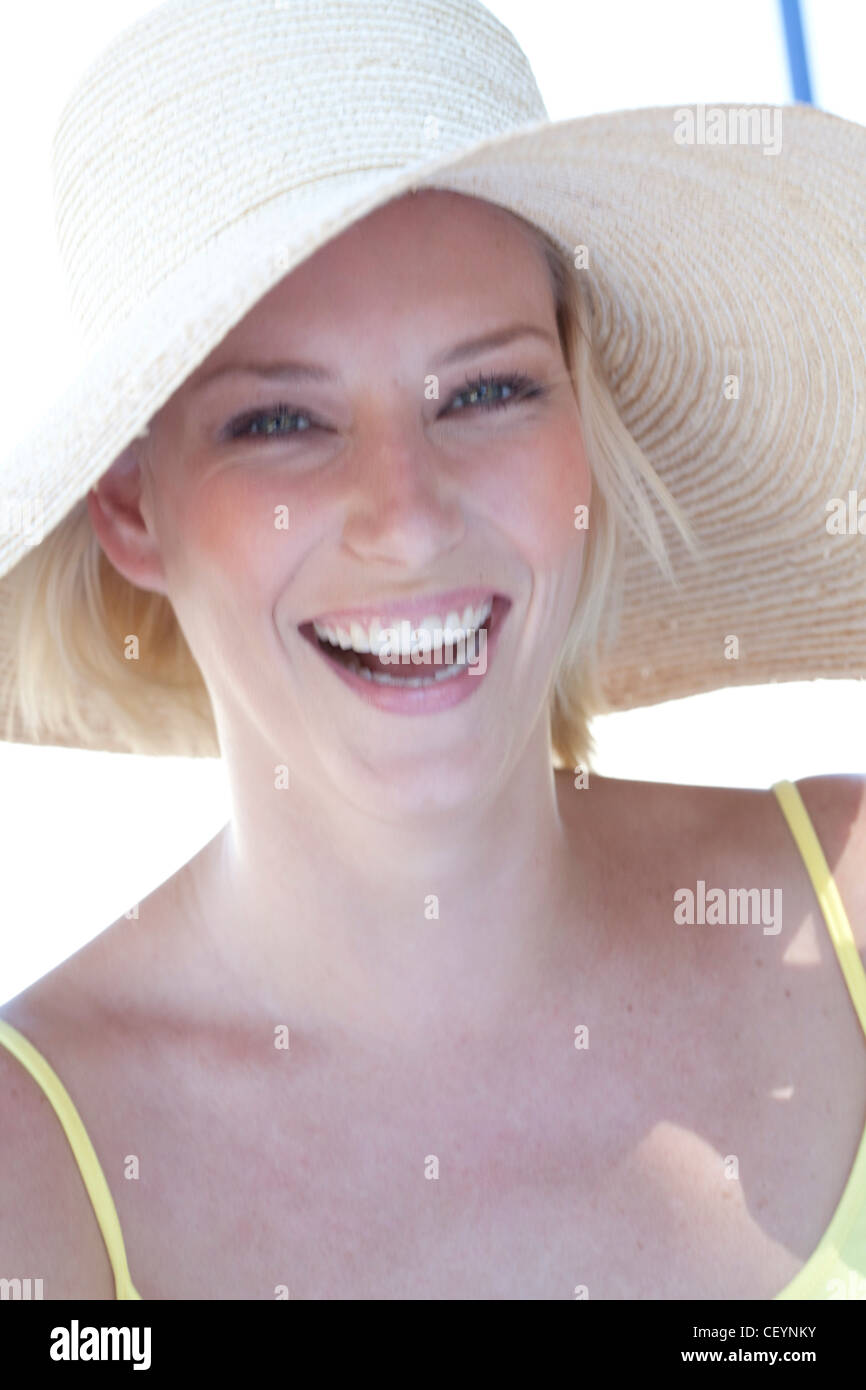 Female wearing wide-brimmed straw hat - Stock Image