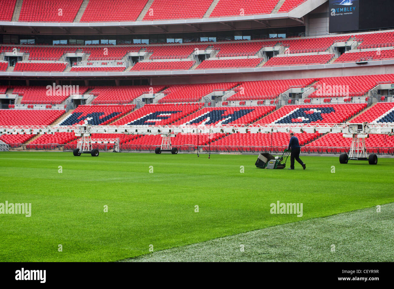 Groundsman cutting the pitch at Wembley Stadium - Stock Image