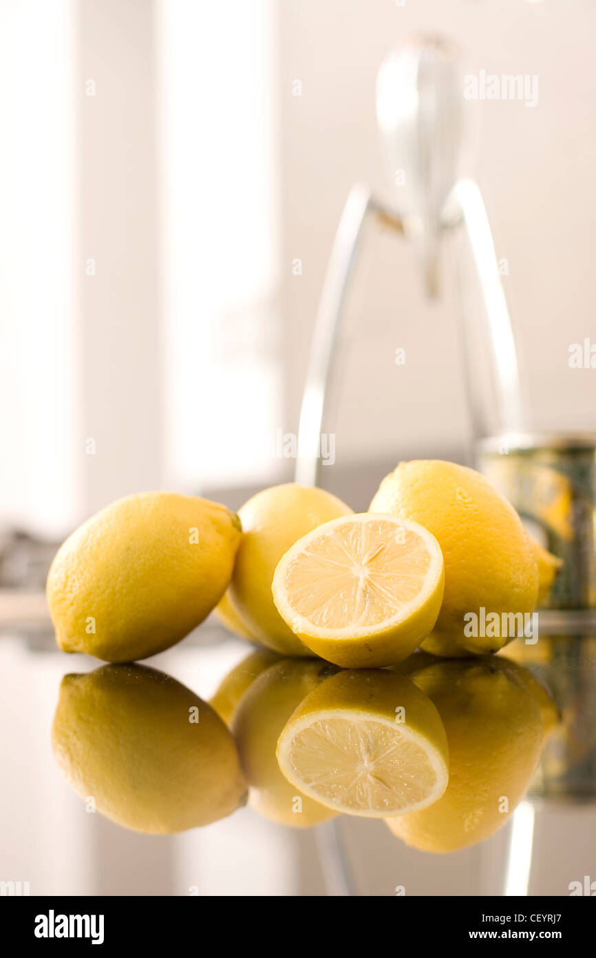 Lemons and an Alessi Juicy Salif Juicer by Philippe Starck in the background Stock Photo