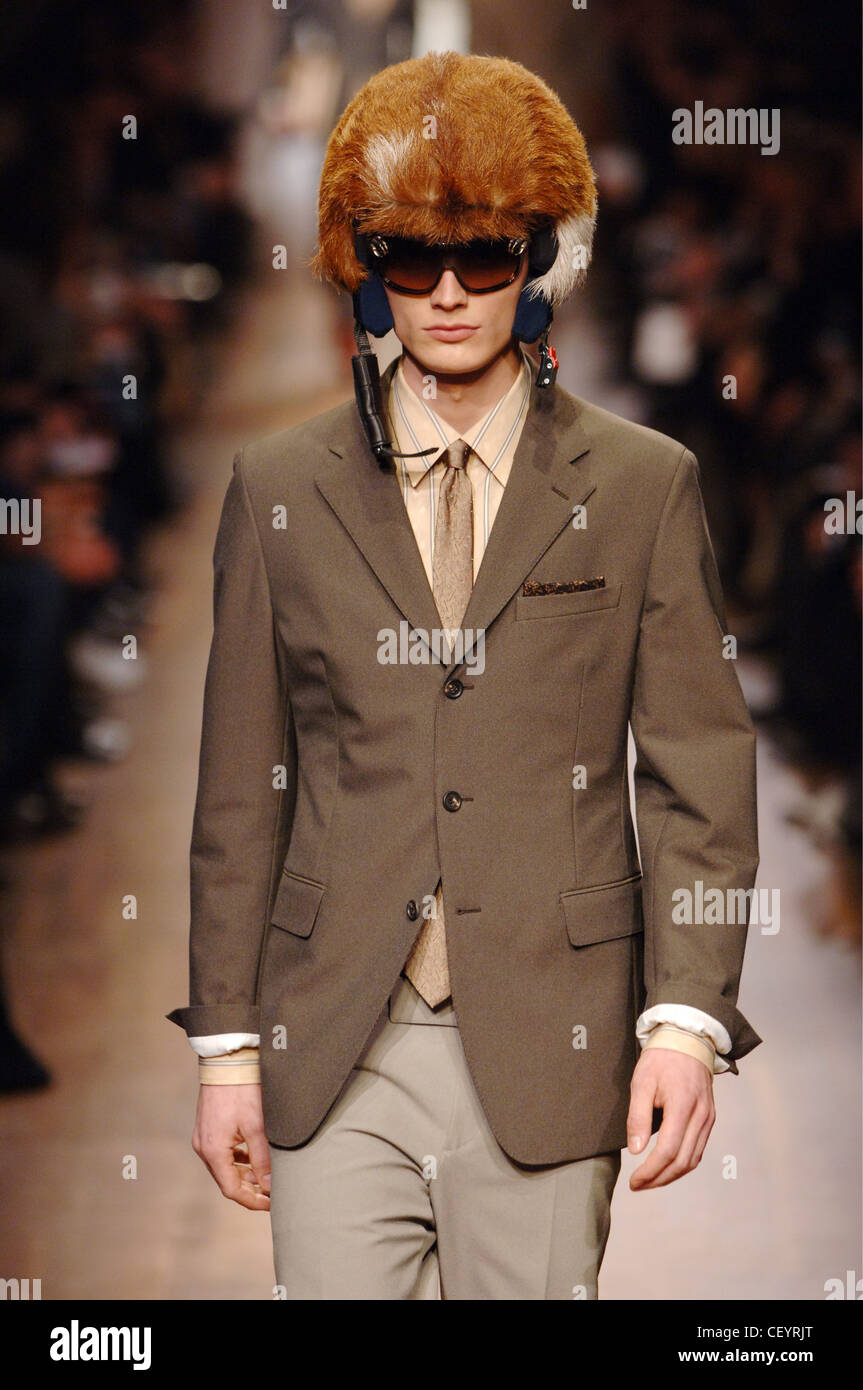 a0b5cb3bdbd15 Prada Menswear Milan A W Male wearing a fitted suit in brown shades with a brown  fur covered helmet and dark sunglasses