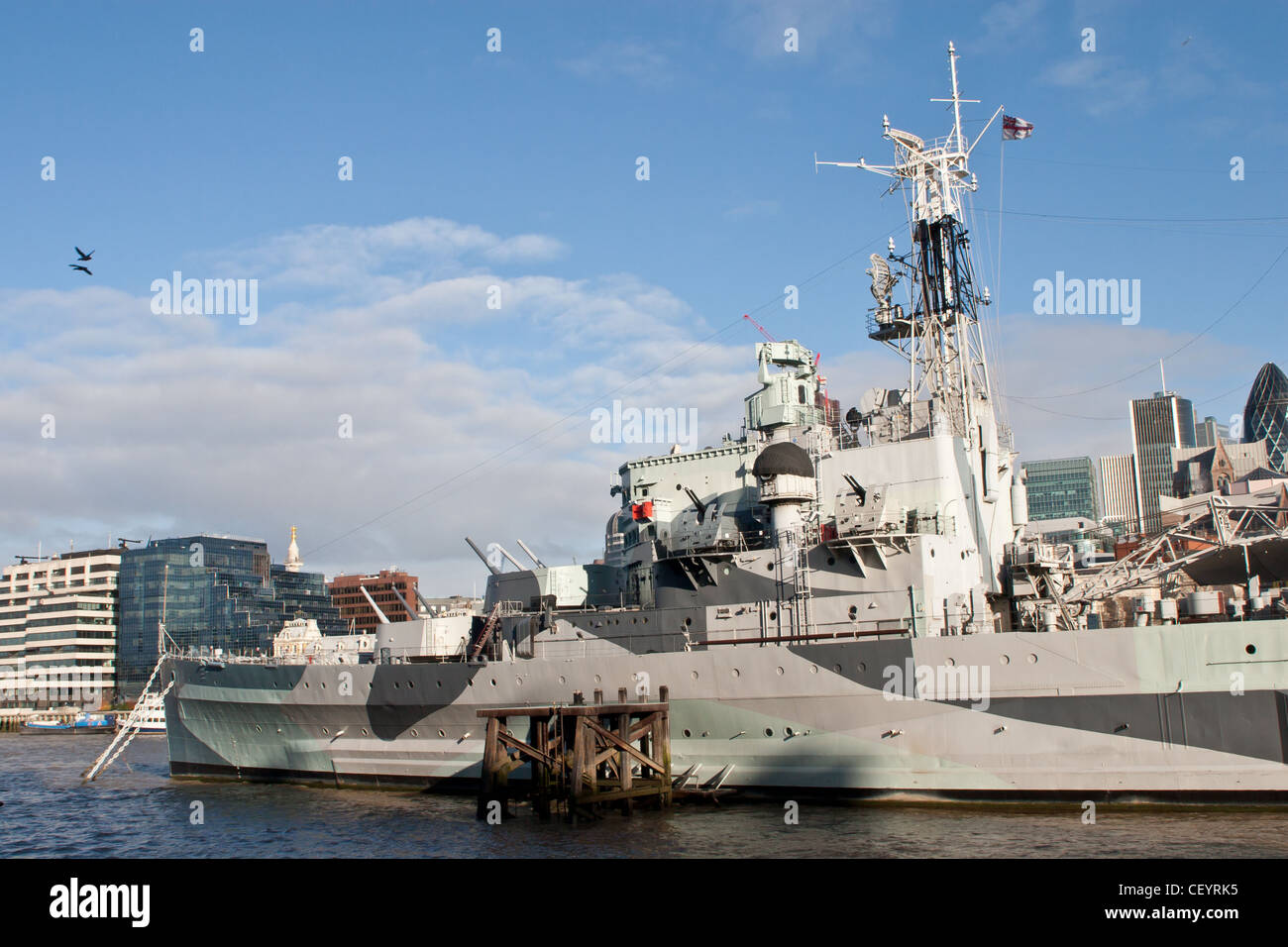 HMS Belfast moored on the River Thames, London. - Stock Image