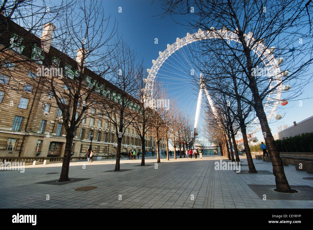 Tourists heading towards the London Eye in Lambeth - Stock Image