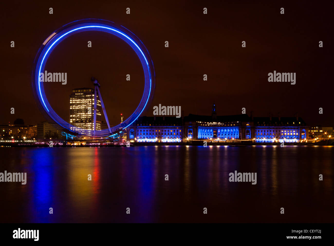 London Eye and County Hall at Night - Stock Image