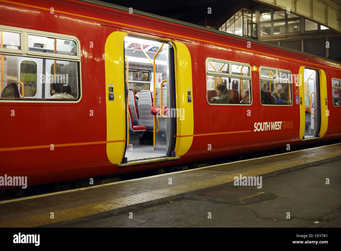 A South West train waiting on a platform in Wimbledon station. - Stock Image
