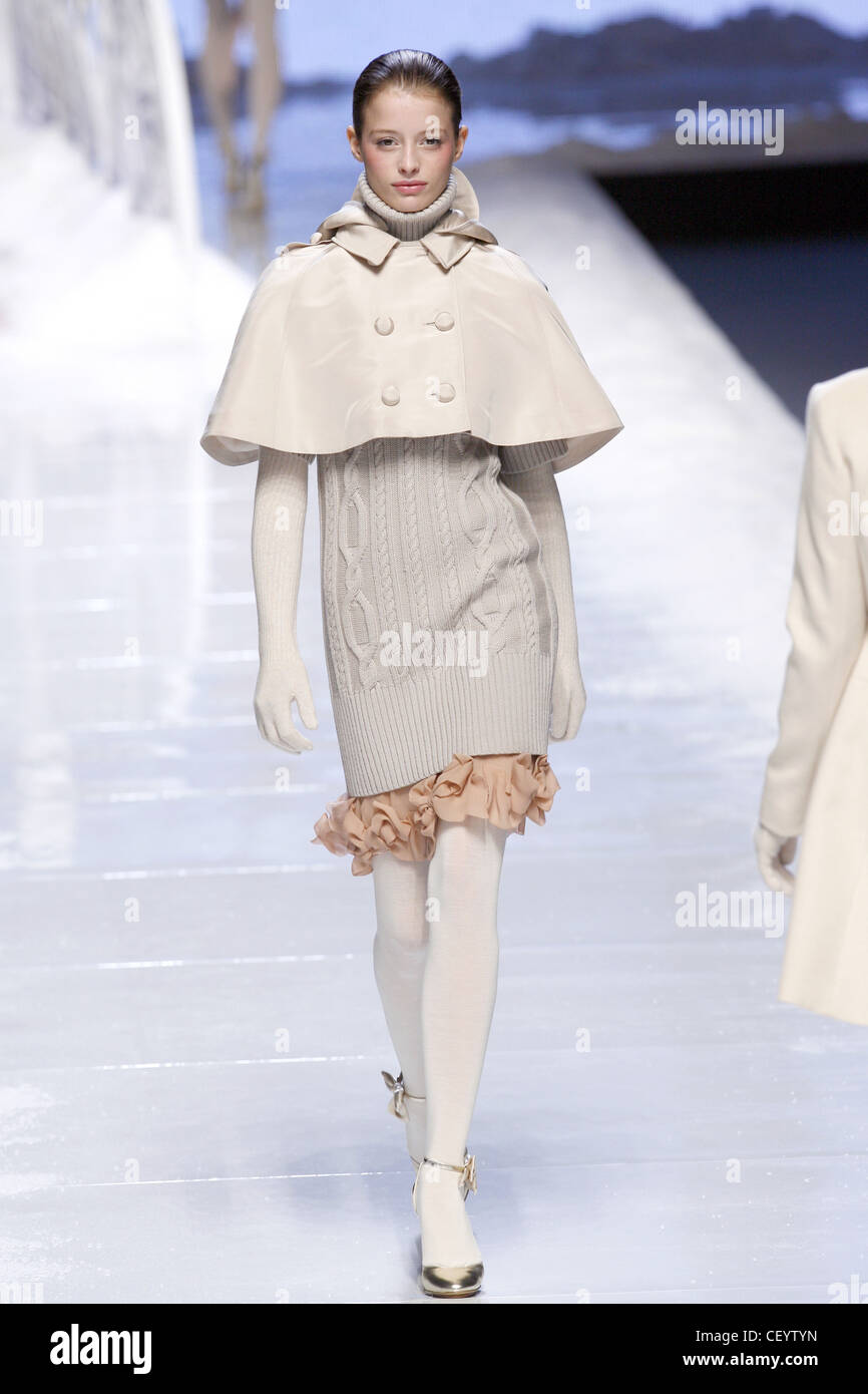 Blu Girl Milan Ready to Wear Autumn Winter Model wearing short white cape, white cable knit dress, white knitted - Stock Image