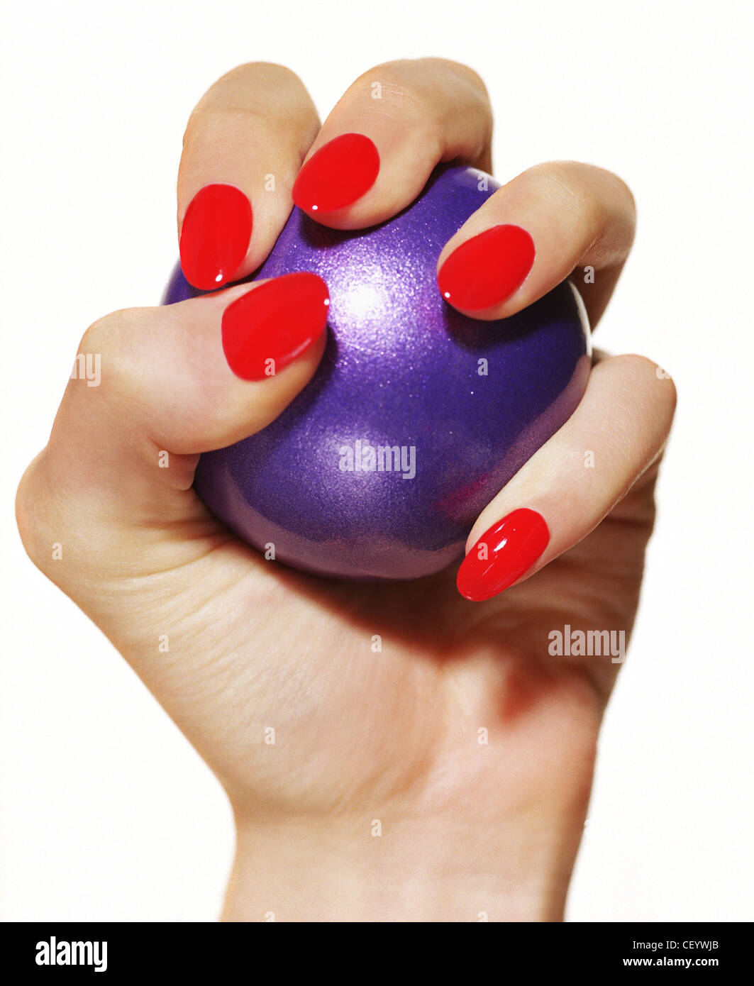 female wearing bright red nail varnish squashing a purple stress