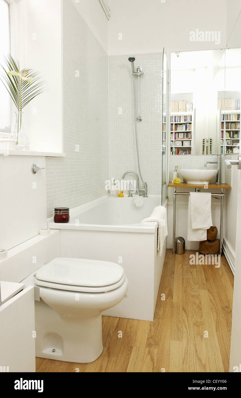 Renovated Flat Interiimage of bathroom white mosaic tiling, wood ...