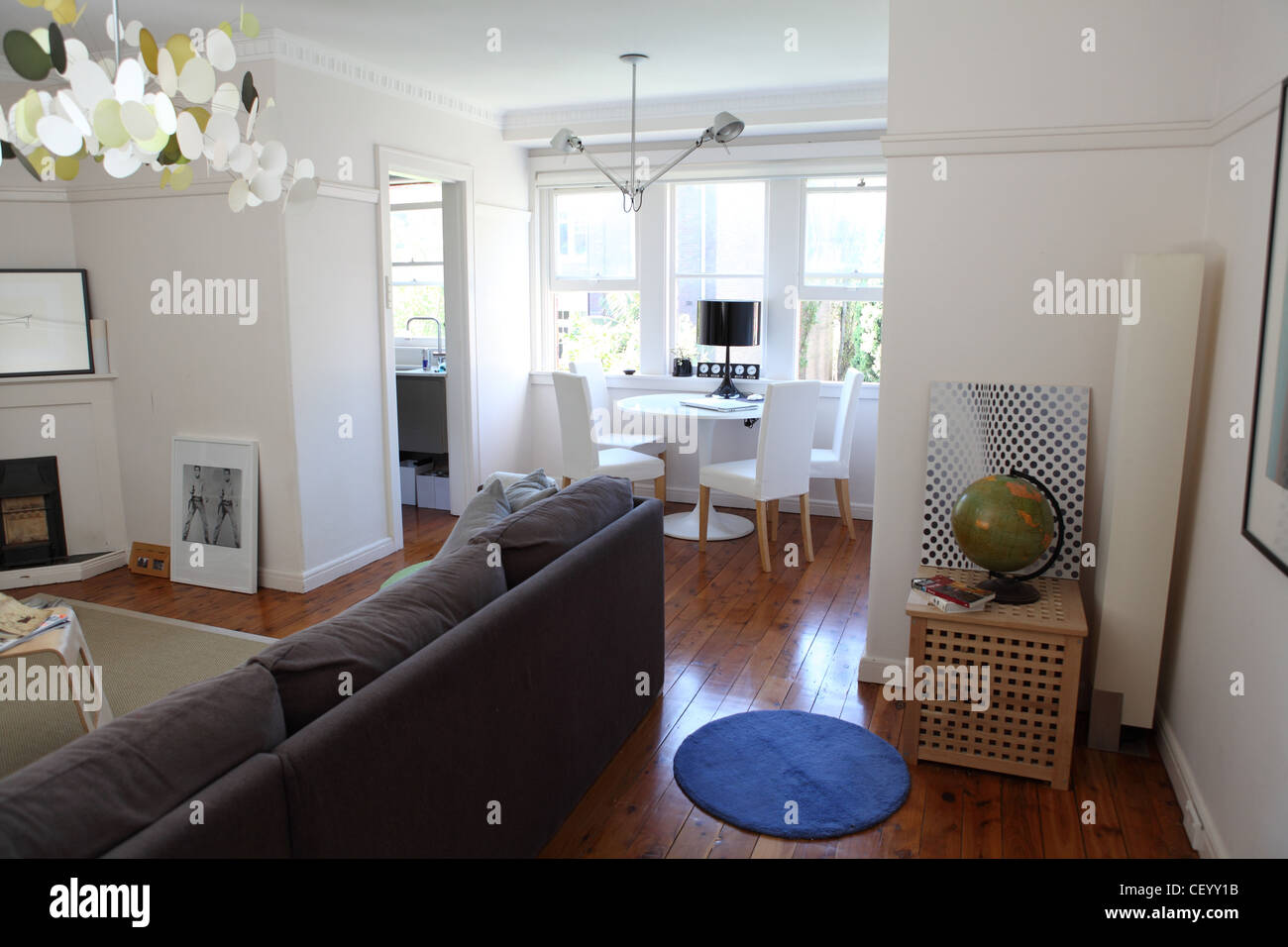 Apartment in Sydney Living room interiwith corner sofa from Habitat, Butterfly pendant chandelier from Ambience Stock Photo