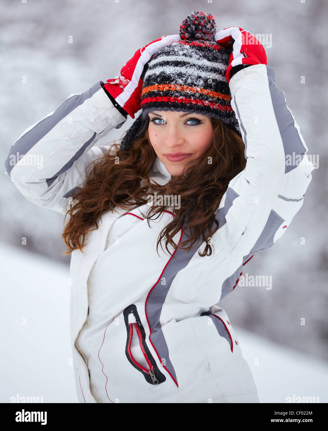 Portrait of a beautiful 20 year old woman outdoor in winter. - Stock Image