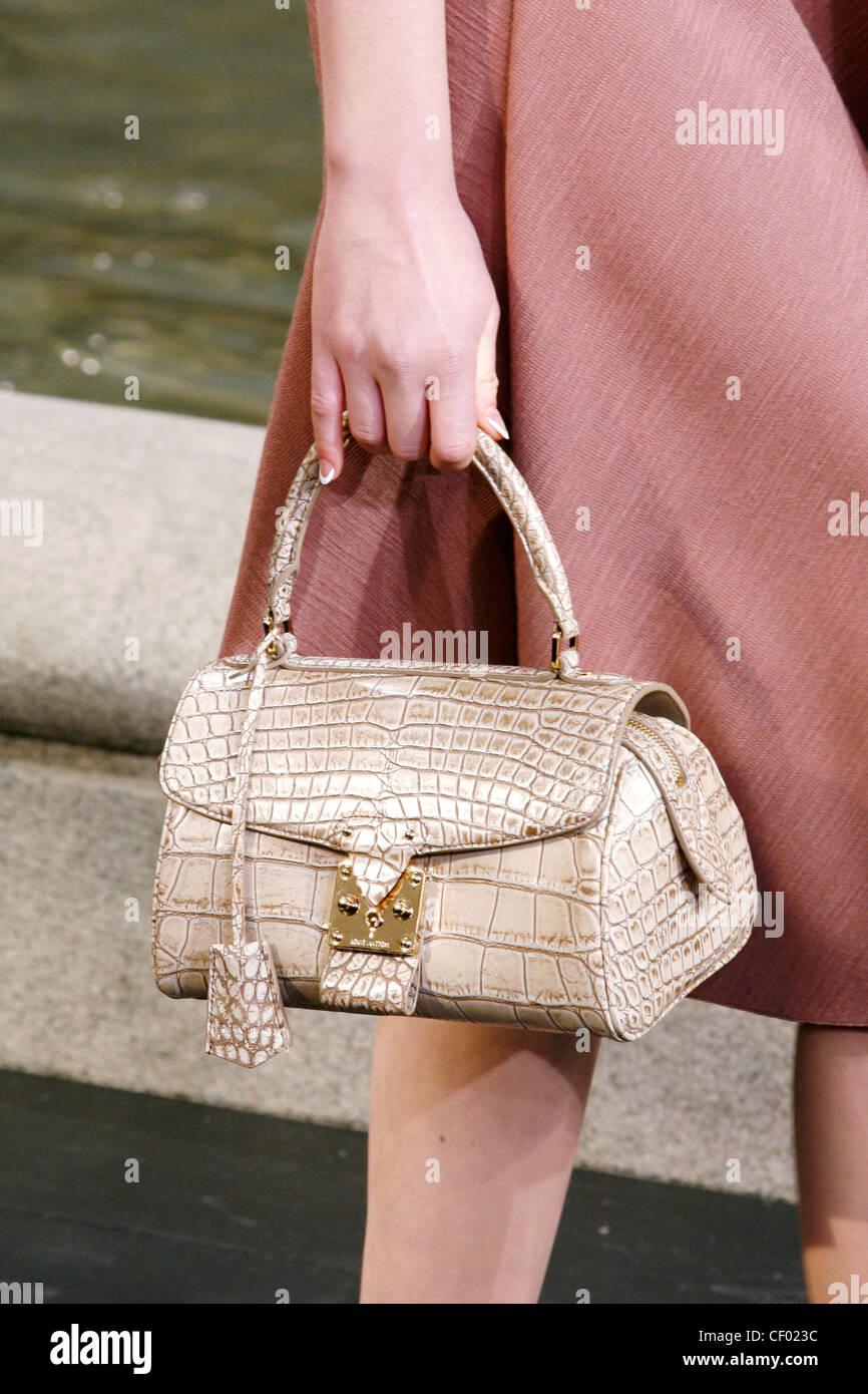 A pale pink mock croc handbag - Stock Image