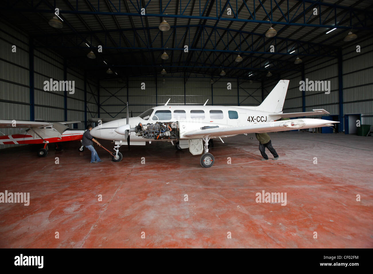 A Piper PA-31 twin-engined aircraft at the hangar of Sde Teiman airfield in Southern Israel - Stock Image
