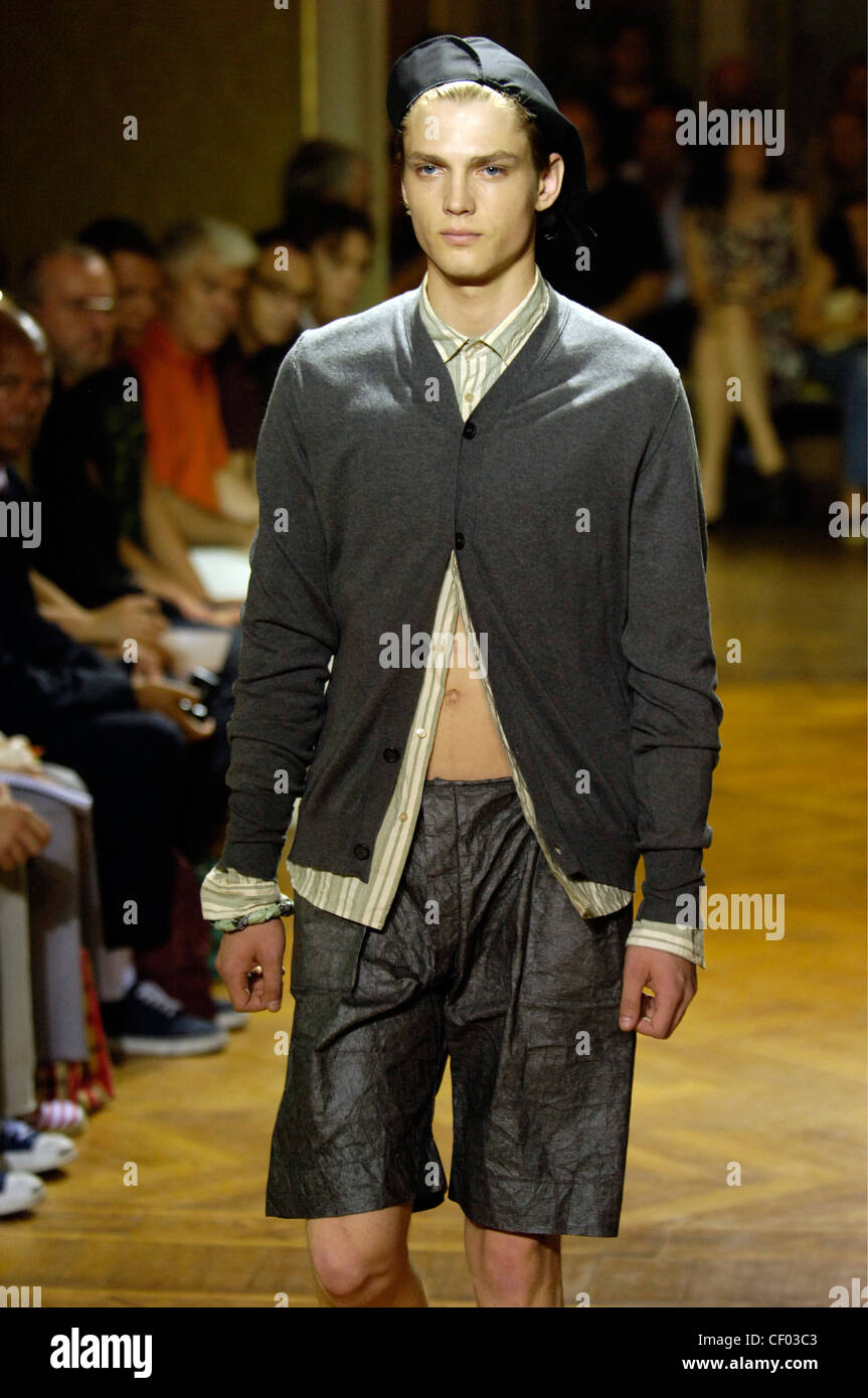 a96a09855dd Miu Miu Milan Ready to Wear Menswear Spring Summer Brunette male model  wearing a khaki and cream striped shirt buttoned at the