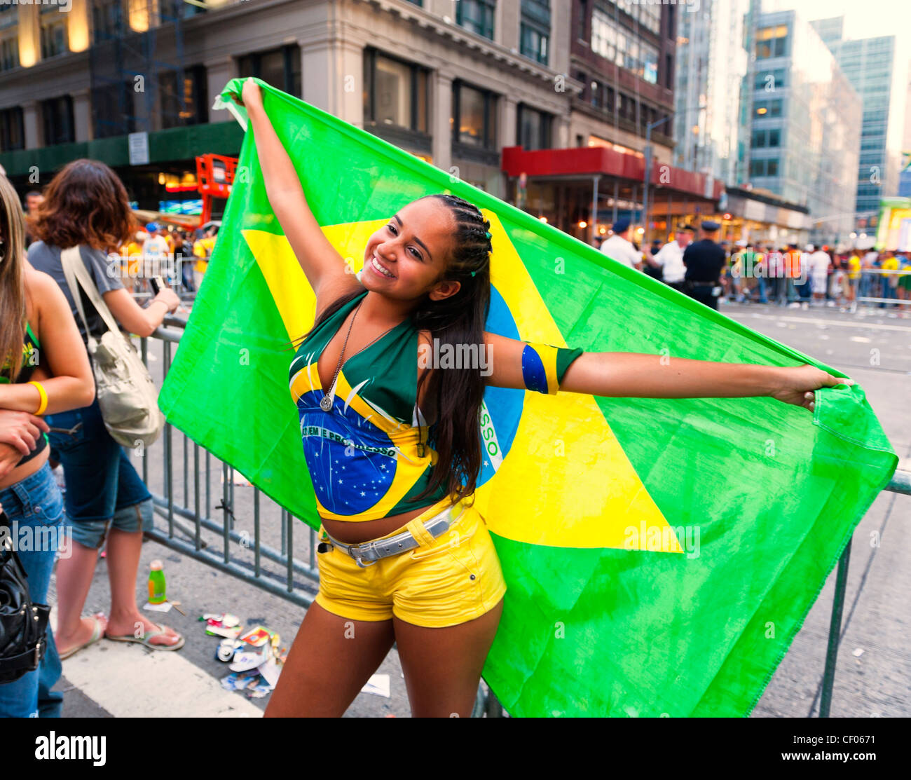 At Brazilian Day Festival, girl posing with Brasil flag, in Little Brazil, New York City, NY USA, on August 31, - Stock Image
