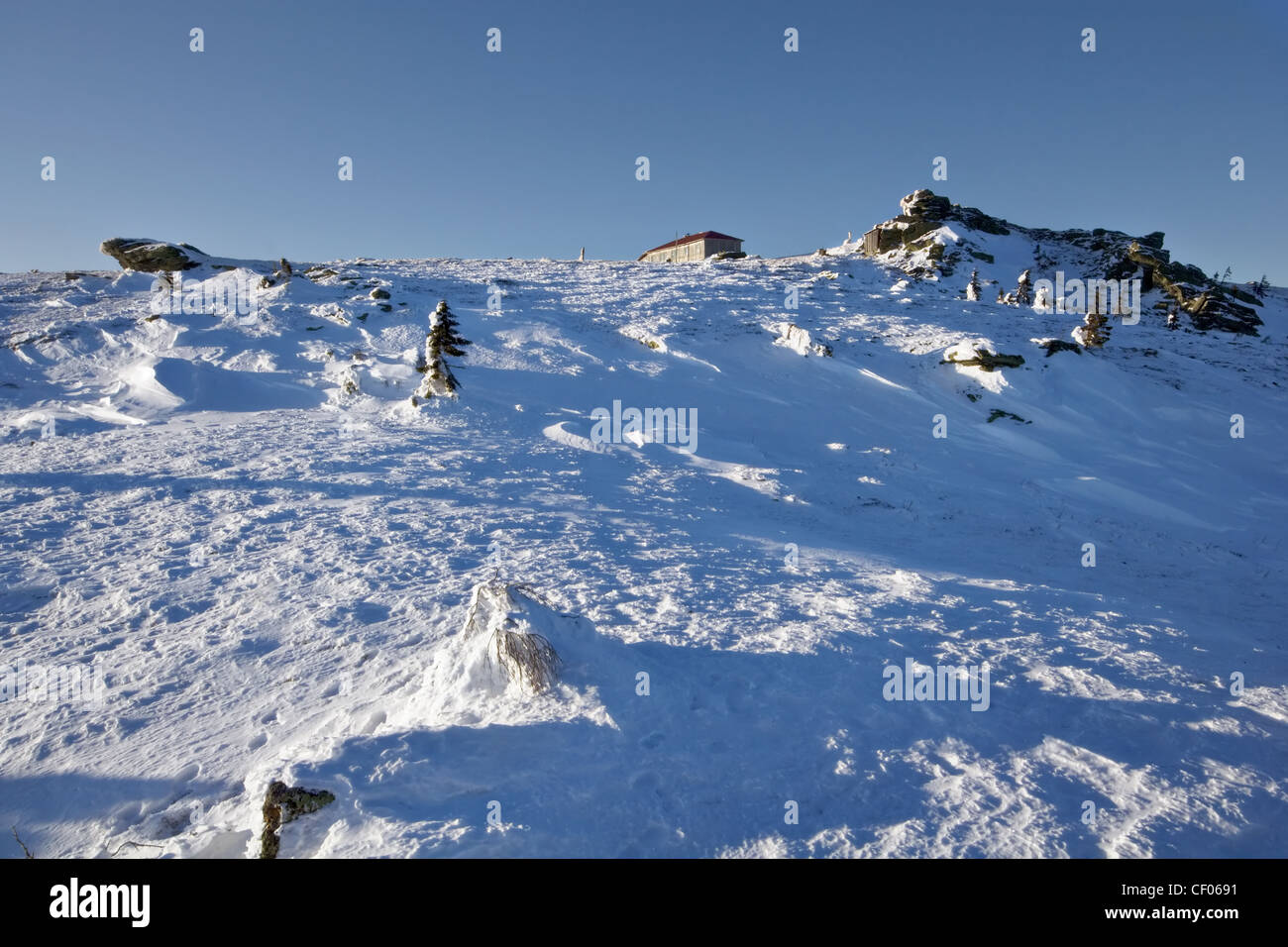 Winter hut at the top of mountain. Ural mountains. National park Taganay. Taiga. Russia. - Stock Image