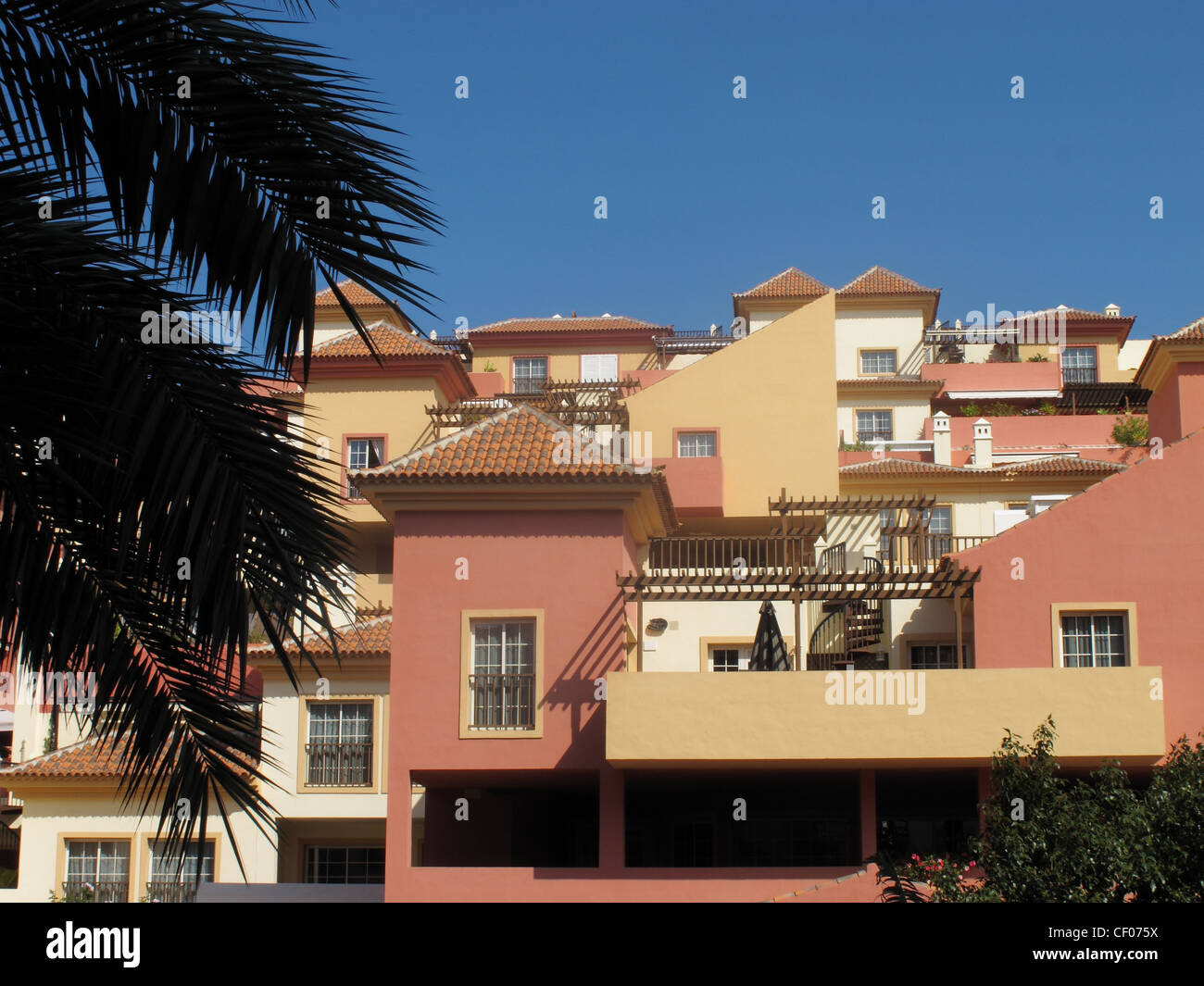 Brightly coloured houses with balconies in Costa Adeje, Tenerife, Canary Islands - Stock Image