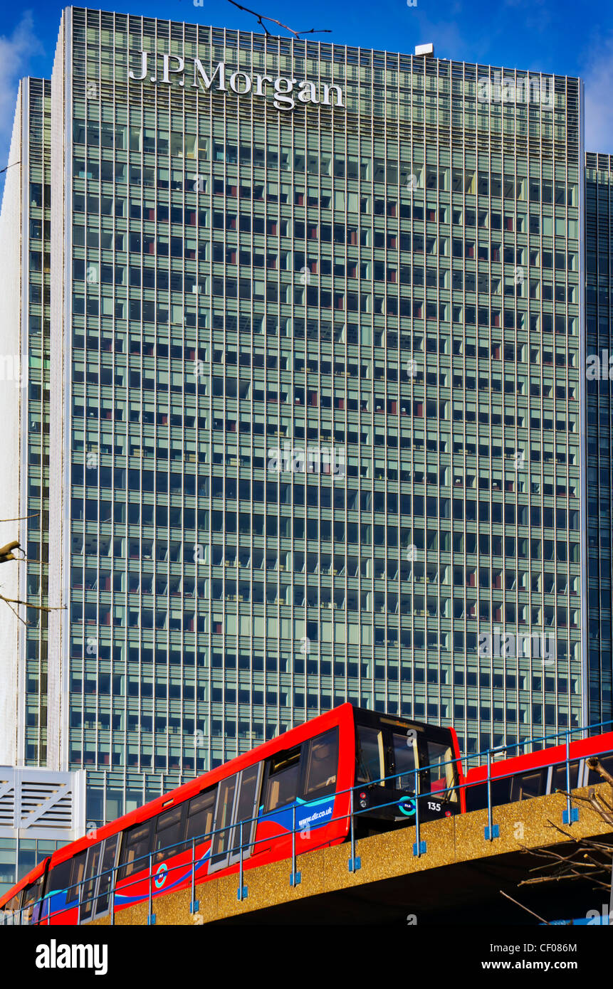 J.P.Morgan building in  Docklands London with DLR train - Stock Image