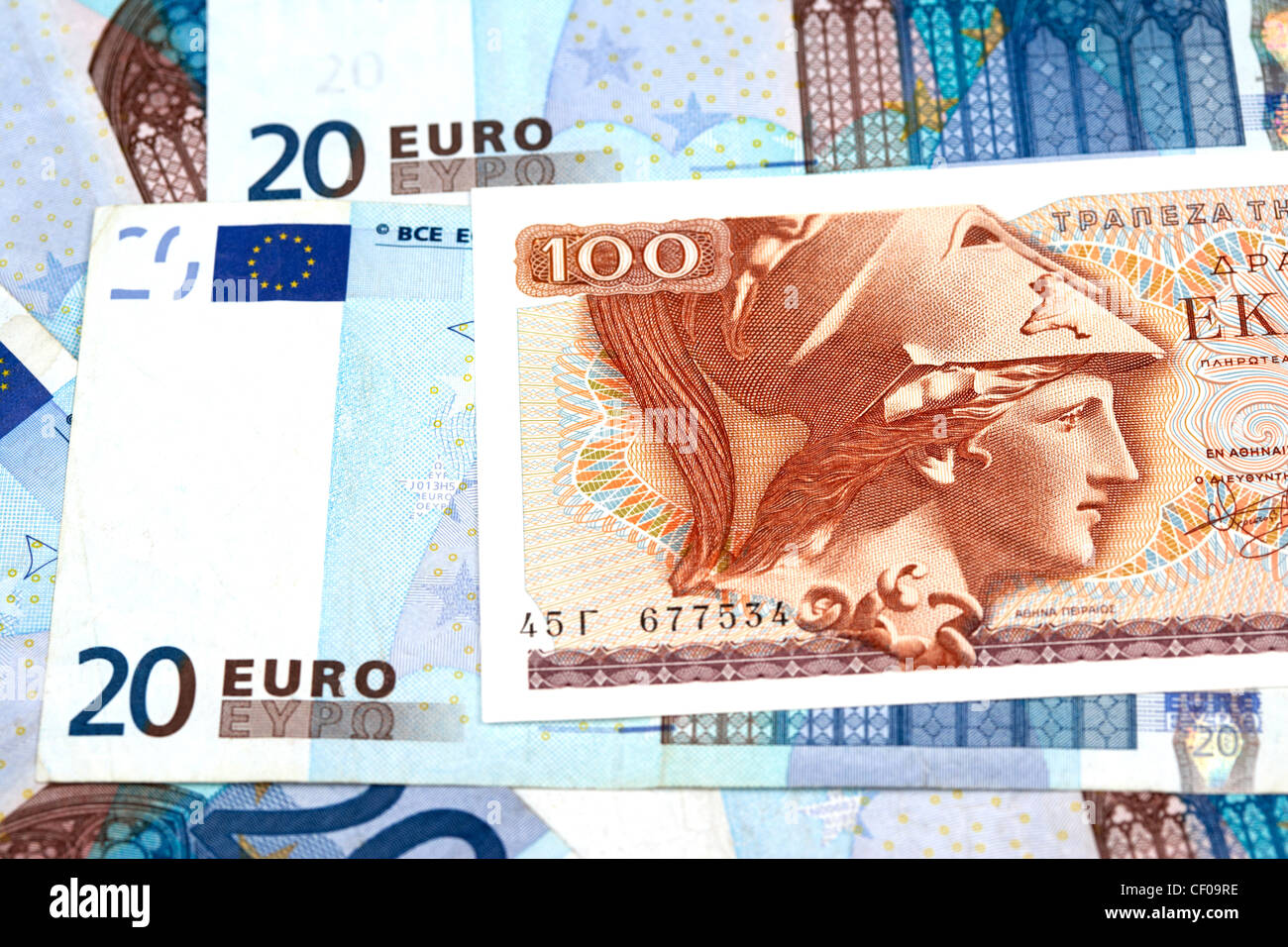 greek drachma and euro banknotes - Stock Image