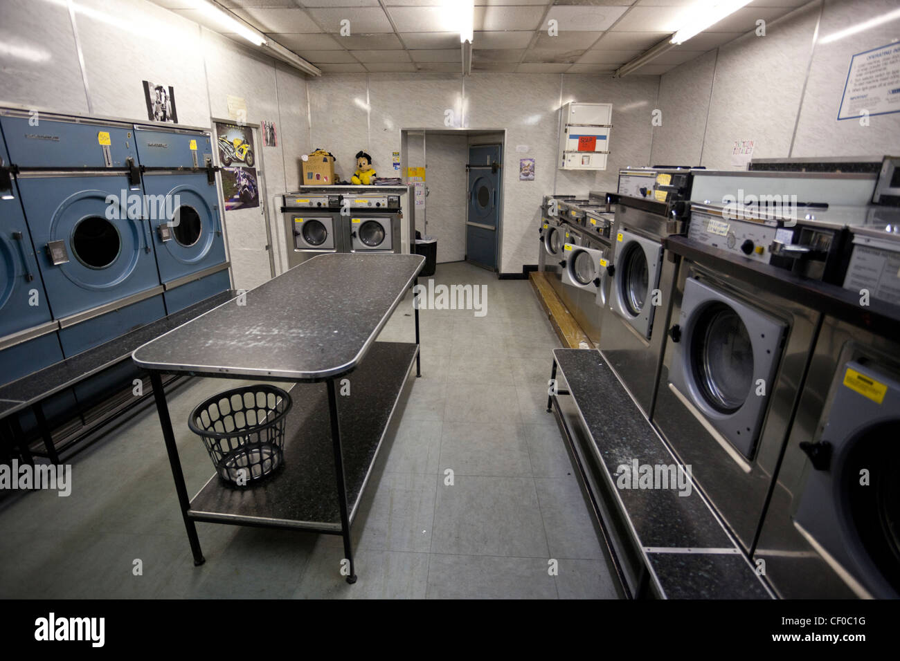 Washing machines and tumbler dryers in an empty laundrette, London, England, UK - Stock Image
