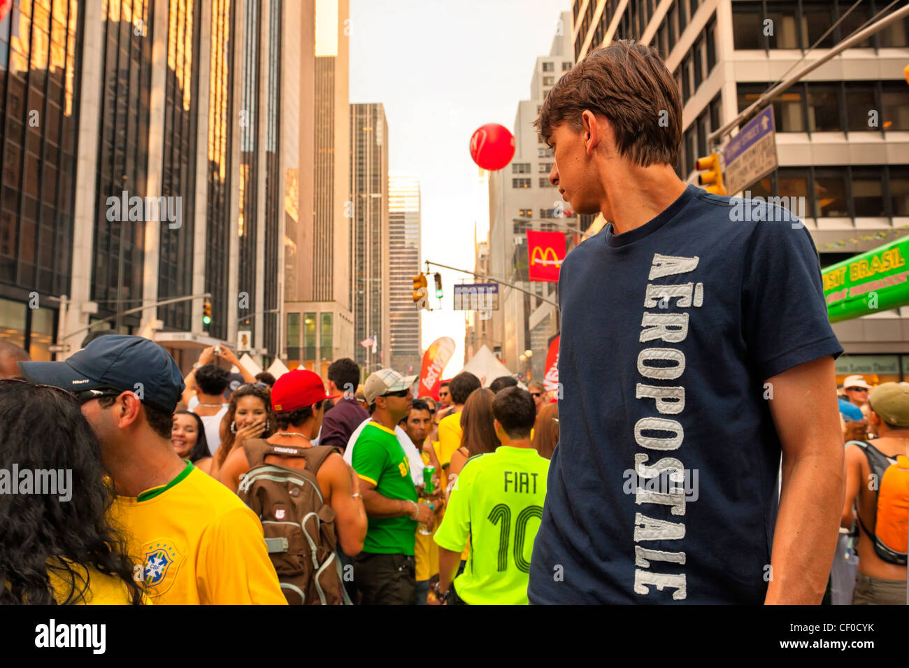 At Brazilian Day Festival, young man on stilts, in Little Brazil, New York City, NY USA, on August 31, 2008. - Stock Image