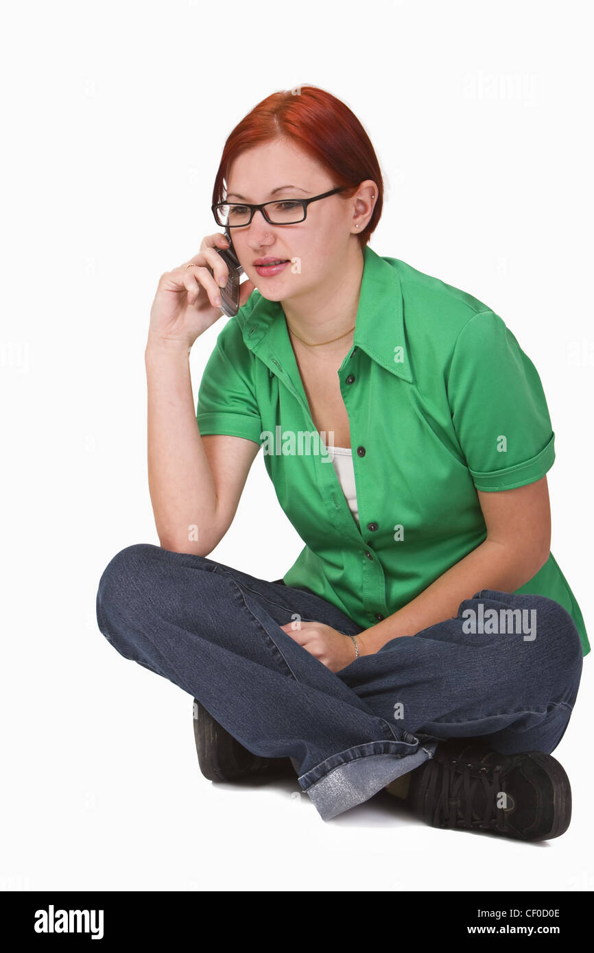 Image of a redheaded teenager girl using a mobile phone. - Stock Image