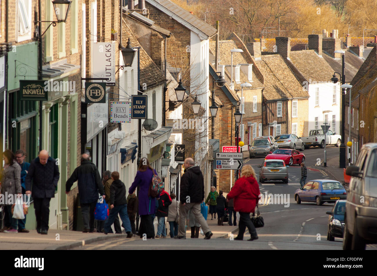 Local people shopping with view down Fore Hill in city of Ely, Cambridgeshire, England. - Stock Image