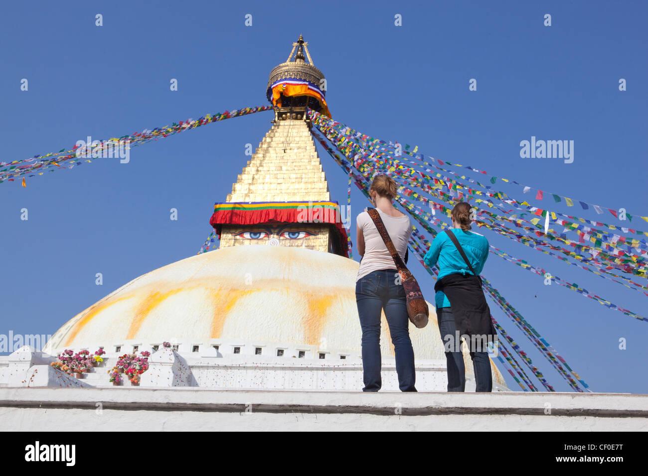 Tourists Bodnath temple Kathmandu Nepal Asia - Stock Image