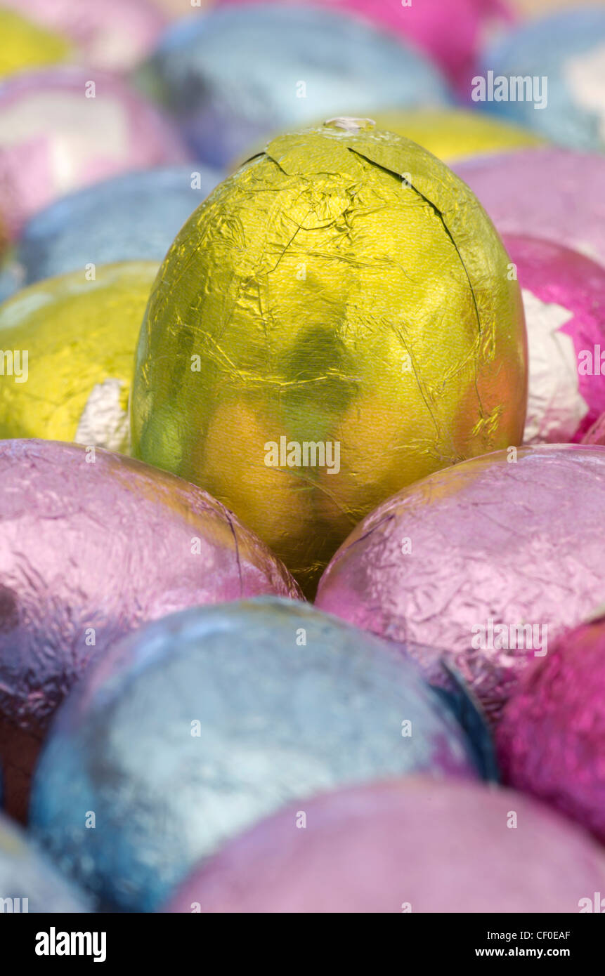 Coloured foil wrapped mini Easter eggs Stock Photo