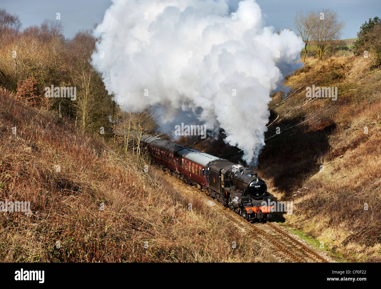 Black 5 loco number 45379  pulls a train at Bradnop on The Churnet Valley Railway, Staffordshire - Stock Image
