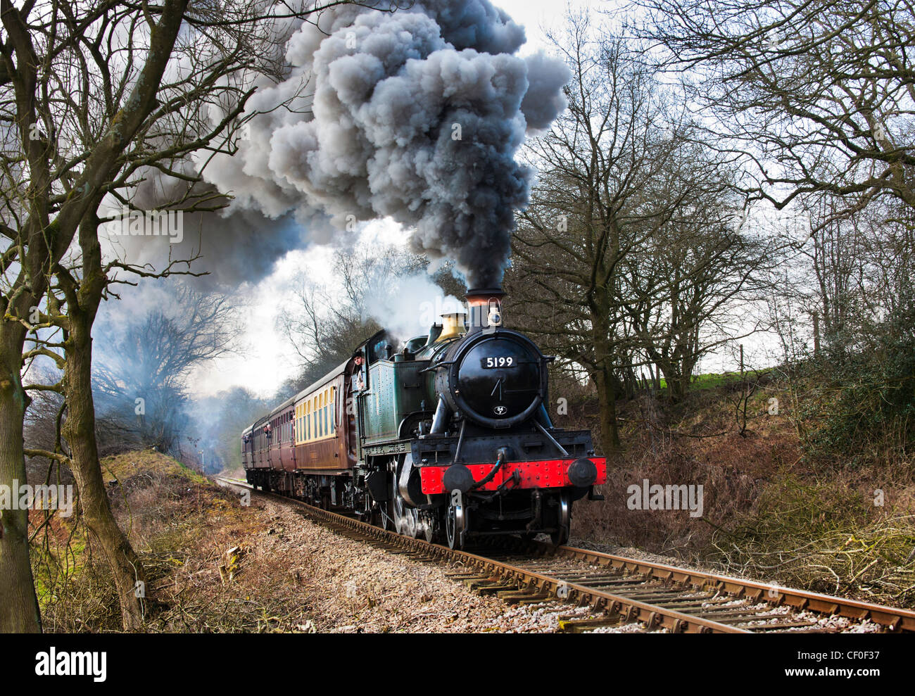 Ex-GWR Prairie Tank loco No 5199 pulls a train out of Leekbrook towards Cauldon Lowe on The Churnet Valley Railway. - Stock Image