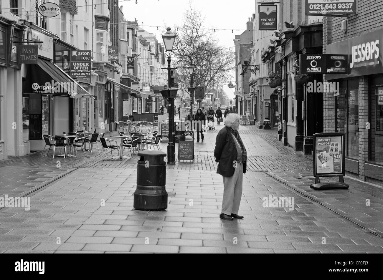 Shopping Precinct with old style buildings in England, UK, in black and white. - Stock Image
