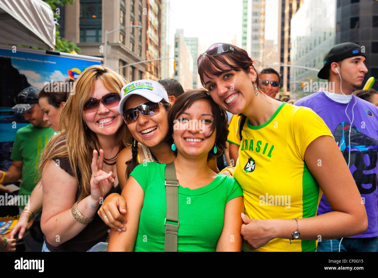At Brazilian Day Festival, four happy young women in crowd, in Little Brazil, New York City, NY USA, on August 31, - Stock Image